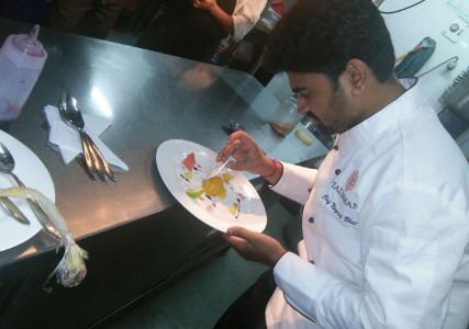 Chef Nagraj Bhat plating a dish
