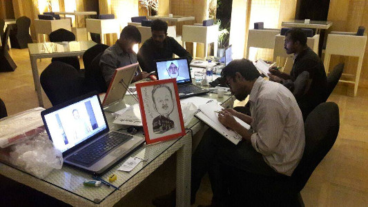 Team Prashant Arts - The Creative Artists engrossed in their creations during a corporate event