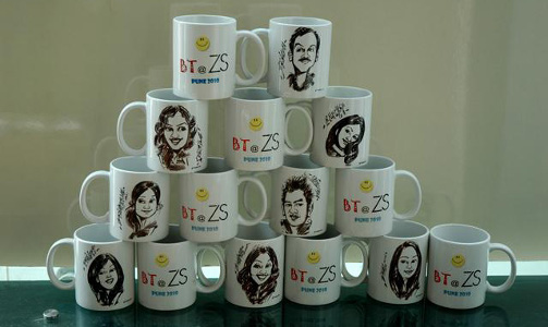 Prashant Arts - Live caricatures on mugs during corporate events