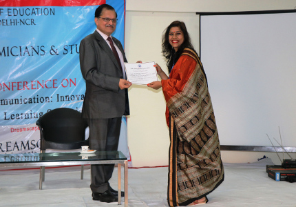 Shikha Sharma receiving the Best Presenter Award at ELLCIATLS 2017 conference