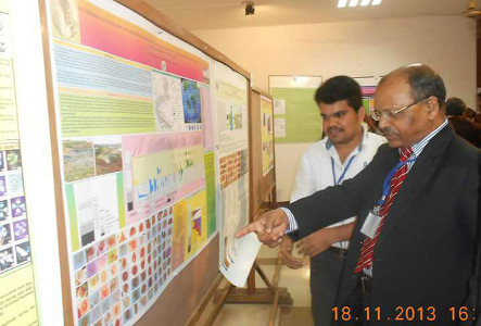 Dr Daramsothu Seetharam presenting his research to Dr M Shanmukhappa, General Manager, Palaeontology Division, ONGC at WIHG Dehradun in 2013