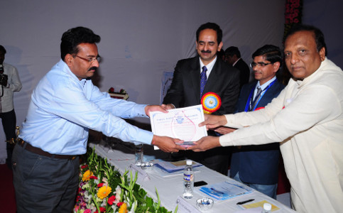 Dr Ravindra Gaikwad receiving Best Article award 2013 by IWWA