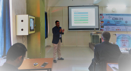 Aditya Tandon presenting his research in a conference in Pune