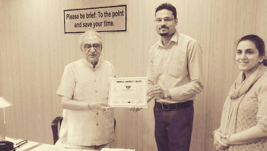 DR Neetesh Jain being felicitated by Dr.K.L.Thakral, Honourable Chancellor, Oriental University, Indore