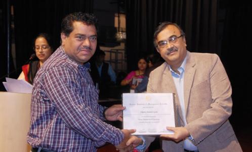 Dr Dipak Gade - Accepting Certificate from Prof Bhattacharya IIM Calcutta
