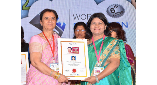 Dr Sandhya Khedekar - received Prof. Indira Parikh 50 women in Education Leaders award by hands of Dr. Indira Parikh Nov 2017